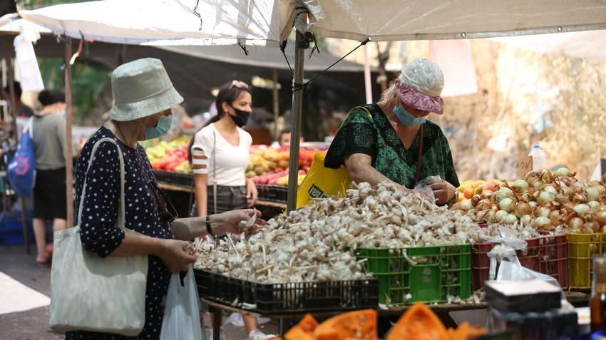 Israelis wear protective face masks at the markt in Tzfat, on July 15.