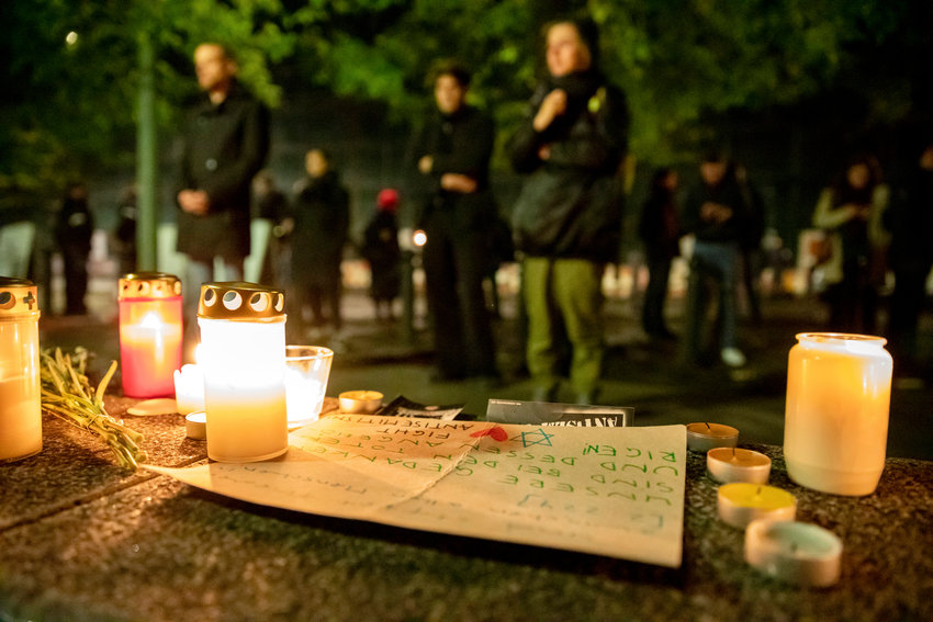 Participants in a solidarity demonstration in the aftermath of the killings in Halle stand before candles at the New Synagogue Berlin, on Oct. 9, 2019.