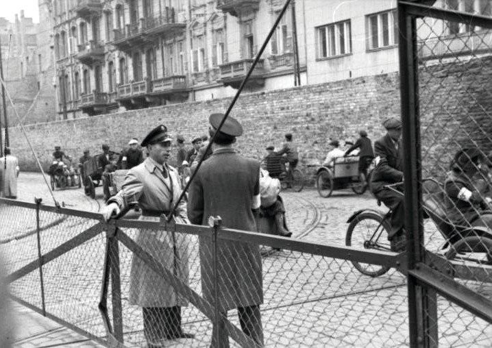 Jewish Ghetto Police guarding the gates of the Warsaw Ghetto, June 1942.