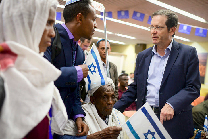 Jewish Agency Chairman Isaac Herzog welcomes members of the Falashmura community at Ben Gurion Airport in 2019.