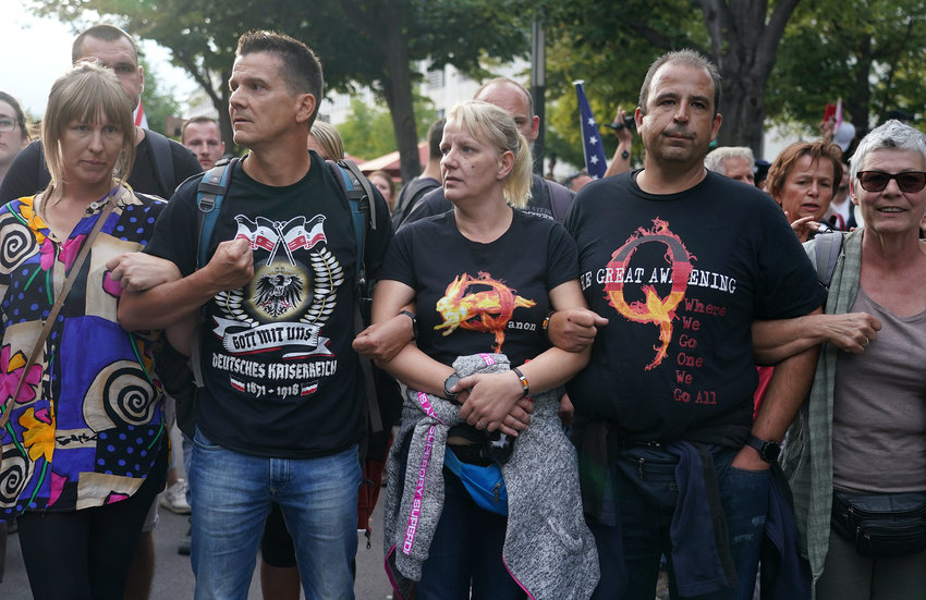 A group of Germans followers of the QAnon conspiracy theory protest in Berlin on Aug. 29, as German extremists inspired by QAnon stormed the country's parliament.