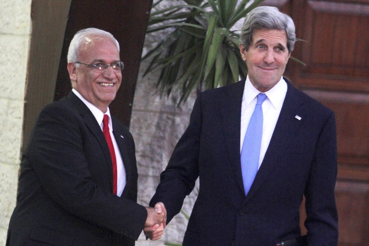 Former Secretary of State John Kerry with chief Palestinian negotiator Saeb Erekat, In Ramallah on April 7, 2013.