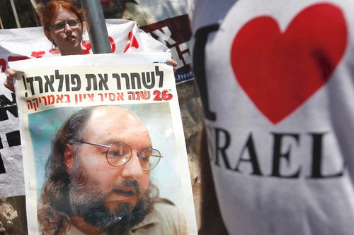 Demonstrators hold signs of Jonathan Pollard as they attend a protest calling for his release outside the house of Israeli President Shimon Peres in Jerusalem, where he met with U.S. congressmen in part to discuss the situation, Aug. 17, 2011.