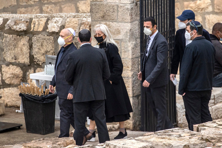Dr. Miriam Adelson arrives at her husband's funeral in the Mount of Olives overlooking the Old City of Jerusalem on Jan. 15.