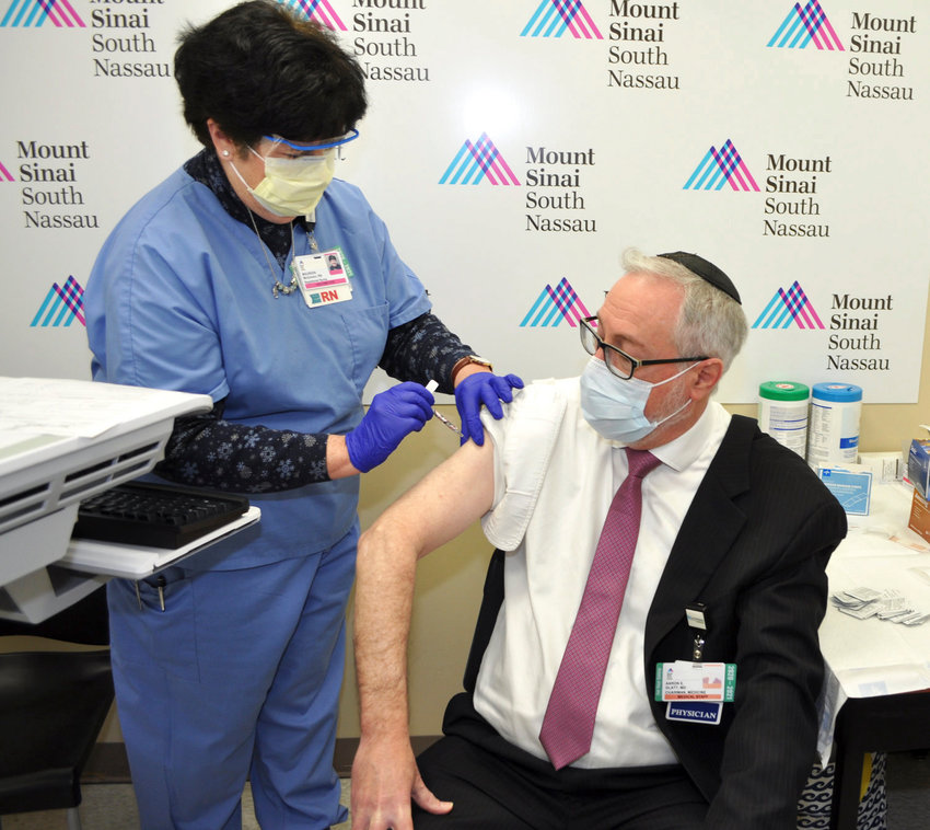 Rabbi Dr. Aaron E. Glatt is pictured receiving a Covid-19 vaccine at Mount Sinai South Nassau.