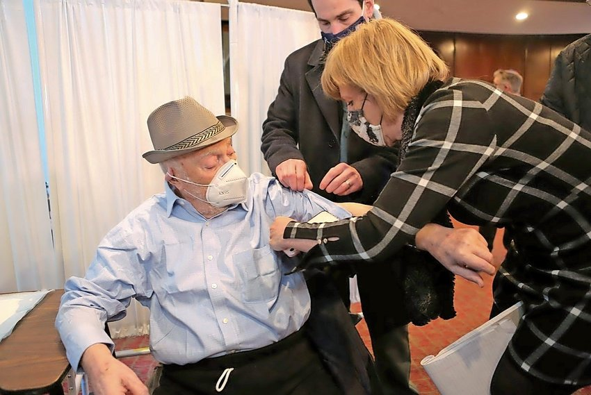 Holocaust survivor Jack Rybsztajn, of Woodmere, is vaccinated at the UJA-NY pop-up jab site in Lawrence on Sunday.