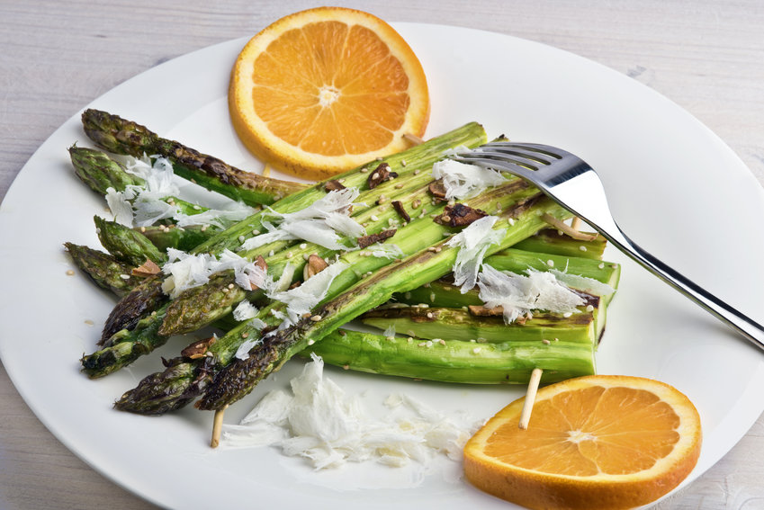 Sesame and garlic grilled asparagus rafts with parmesan shavings and orange.