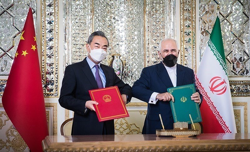 Iranian Foreign Minister Mohammad Javad Zarif and State Councilor of the People's Republic of China Wang Yi at the signing of the Iran–China 25-year Cooperation Program in Tehran in March.