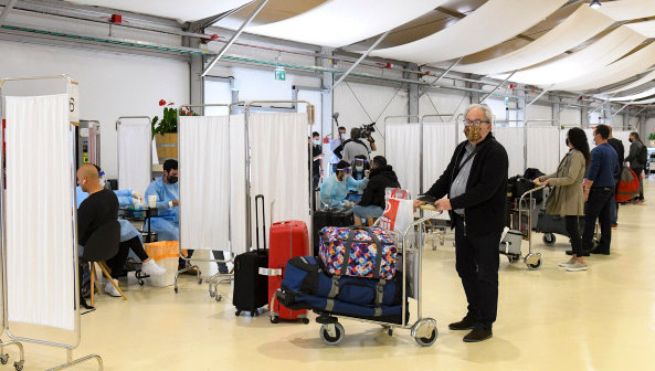 Medical technicians test passengers for COVID-19 at the Ben Gurion International Airport near Tel Aviv on March 8.