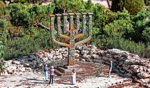 The great symbol of biblical Israel, the menorah, is an inverted pyramid or ziggurat, broad at the top, narrow at the base. This is the Knesset Menorah, in the Rose Garden in front of the gates of the Knesset, standing 14 feet high and weighing 4 tons.