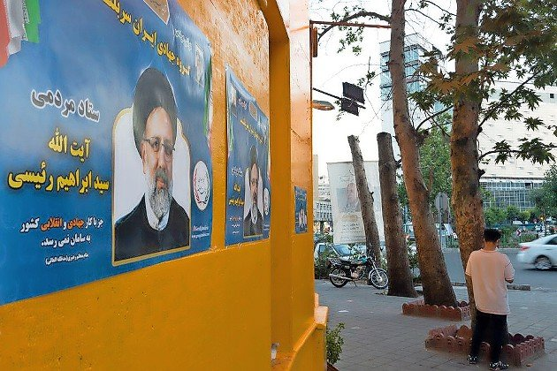Ebrahim Raisi Poster on a wall on a street in Tehran during the residential election.