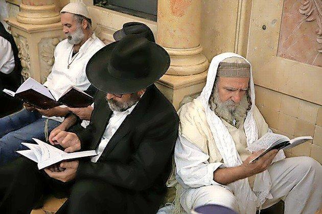 Jews pray at Meron on the eve of Tisha B'Av, on Aug. 10, 2019.