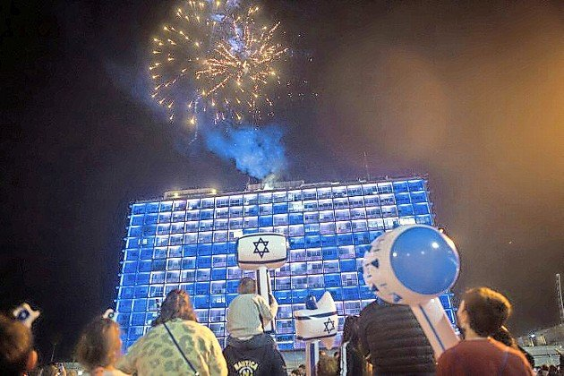 Israelis watch fireworks in Rabin Square in Tel Aviv, during a celebration of Israel's 73rd Independence Day.