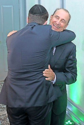 Bone marrow donor and recipient embrace for the first time, at the Ezer Mizion fundraiser. The two men will forever be intertwined.