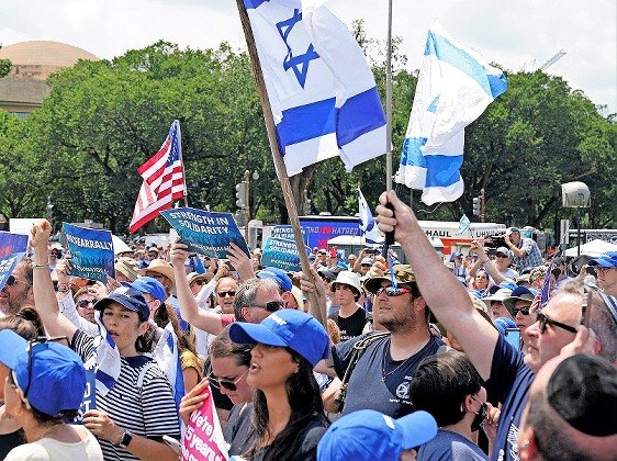 """Spectators at the """"No Fear: A Rally in Solidarity With the Jewish People"""" at the National Mall in Washington on July 11."""