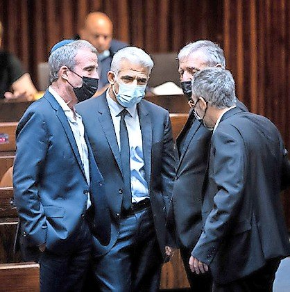 """Yesh Atid parliament members Elazar Stern, Yair Lapid and Meir Cohen during a discussion on the """"family reunification law,"""" during a plenum session in the Knesset on July 6."""