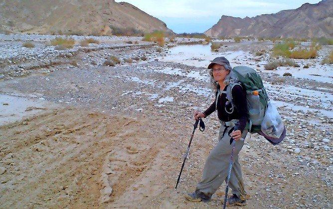 Tzippi Moss hiking after a desert rain.