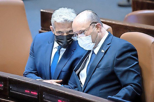 Israeli Foreign Affairs Minister Yair Lapid and Israeli Prime Minister Naftali Bennett during a plenum session in the Knesset on Aug. 2.