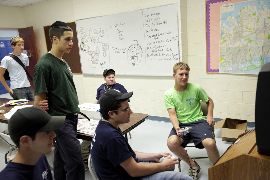 Camp counselor Yigal Rosengarten, 19, center, plays video games with Jack Antilla, 15, right, at Hillel Day Camp, Thursday, July 22, 2010, as Ilan Liechtung, 21, center rear, Mike Bromley, 22, leftmost, Yehuda Weinstein, 17, left, and Mark Weingarten, 20, left rear, look on.