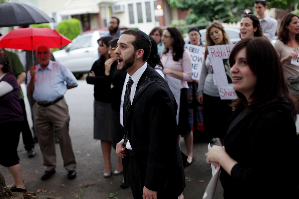 Rabbi Jeremy Stern, center, Executive Director of The Organization for the Resolution of Agunot, leads a rally to denounce Aharon Friedman who will not give his wife a get, despite the fact that they have already been granted a divorce in civil court, in Brooklyn, Wednesday, August 18, 2010.