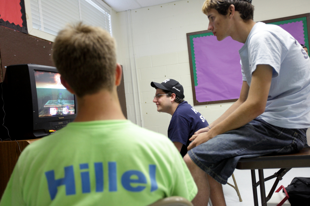 Yigal Rosengarten, 19, center, plays video games with fellow counselor Mark Weingarten, 20, right, and Jack Antilla, 15, at Hillel Day Camp, Thursday, July 22, 2010.