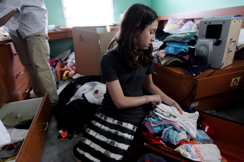 Dafna Katz, 12, of North Woodmere, is pictured packing in her room, Tuesday, June 22, 2010. Katz and her family are moving to Chashmonaim in the West Bank in August.