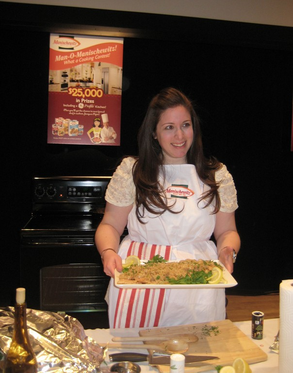 Dina Burcat presents her shallot smothered chicken covered in matzo meal for the Manischewitz cook-off.