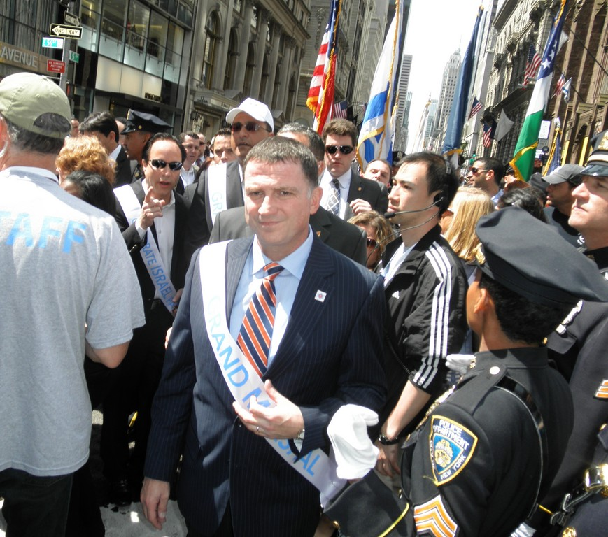 Yuli Edelstein, the Israeli Minister of Information and Diaspora, struts through a throng of media and