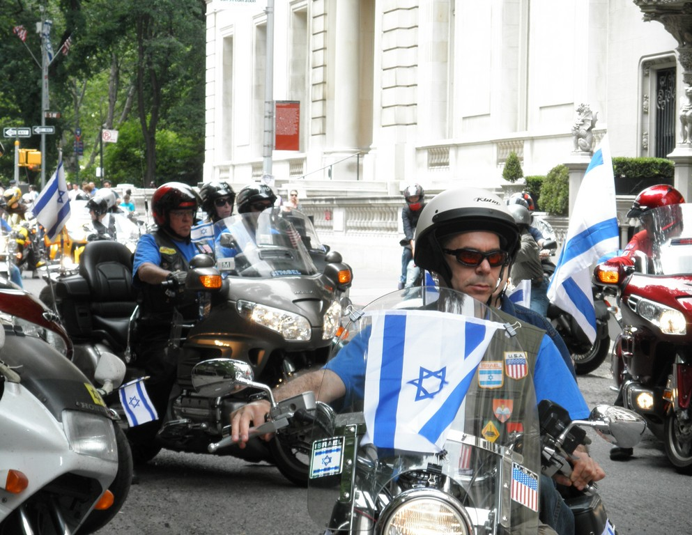 Chai Riders motorcycle club roared up Fifth Avenue in full patriotic display.