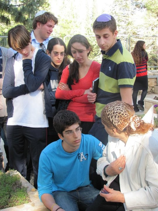 Members of Write On For Israel console Erez's mother at his gravesite