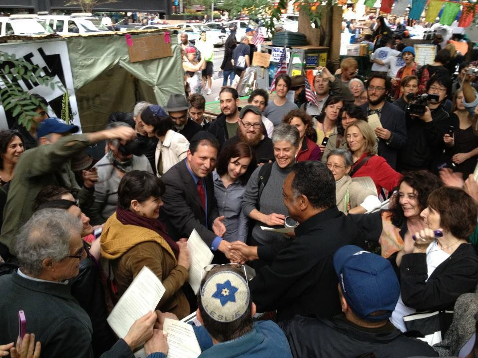 Brooklyn Councilman Brad Lander shares common cause with Rev. Jesse Jackson at the protesters' Sukkot gathering.