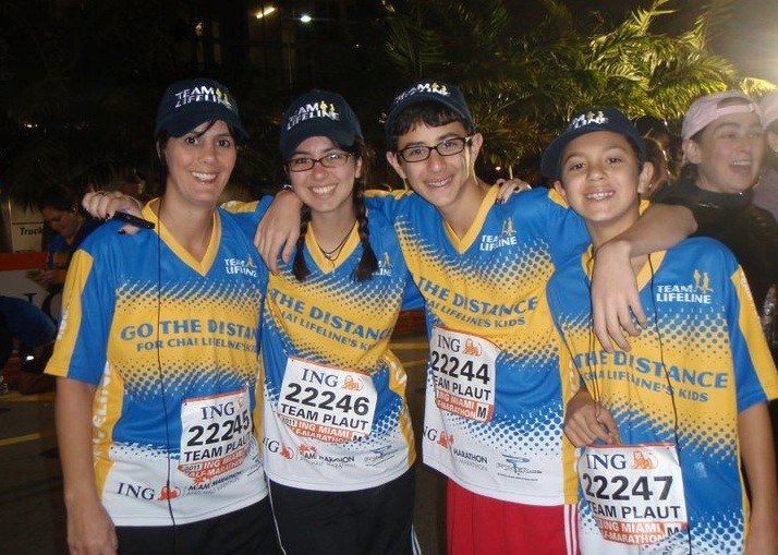Tova Plaut ran last year for Chai Lifeline in Miami with her children Raquel, Jake and Sammy.