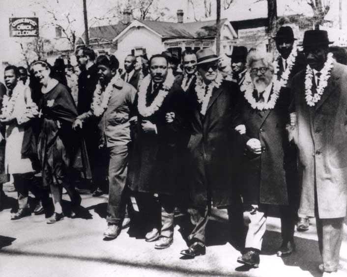 Rabbi Abraham Joshua Heschel marches along side Martin Luther King Jr.  in Selma, Alabama.