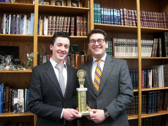 Mathew Goldstein (l) and Hillel Friedman proudly display their trophy earned at the debate tournament.
