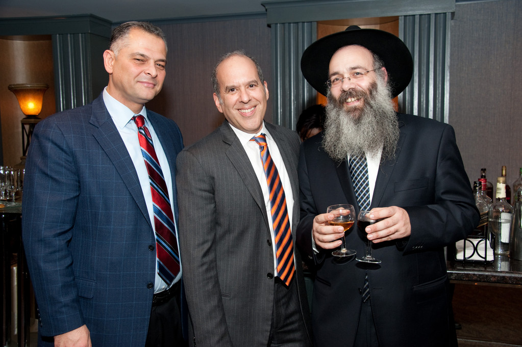 From left Isaac Bitton, Aaron Fischman, Rabbi Wolowik