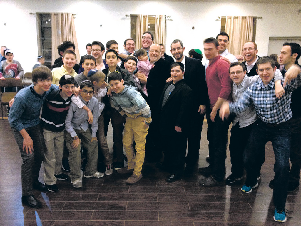 Har Torah Assistant Principal Rabbi Yisrael Silverman, left, and  Rabbi Ahron Rosenthal, Director of Student Activities, right with 8th grade boys at Yachad shabbaton.