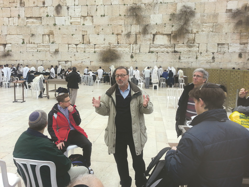 Rabbi Yosef Adler of Teaneck and some of his congregants at the Kotel.
