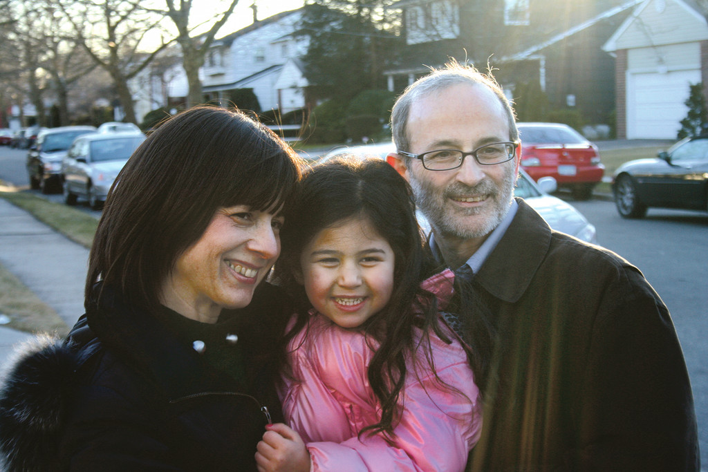 One happy family: from left, Sara, daughter Meira, and Azriel Ganz, foster and then adoptive parents through OHEL.