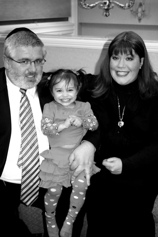 Kayla and Ben Jacobs of Hewlett with foster and then adopted child Eliana.