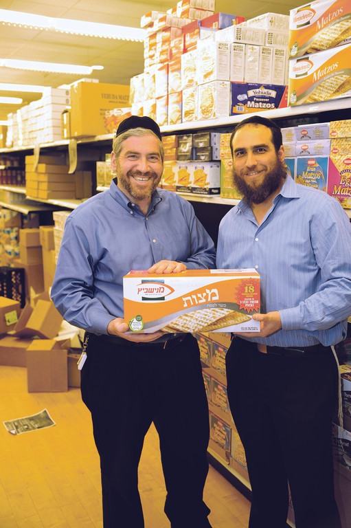 Howie Klagsburn (left) and Shloy Rubinstein have Pesach and matzoh at hand.