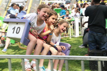 Swinging in the park on Kulanu Sunday: Grace, Liana and Yakira Kollander.