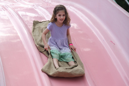 Talia Ross takes a ride on the giant slide.
