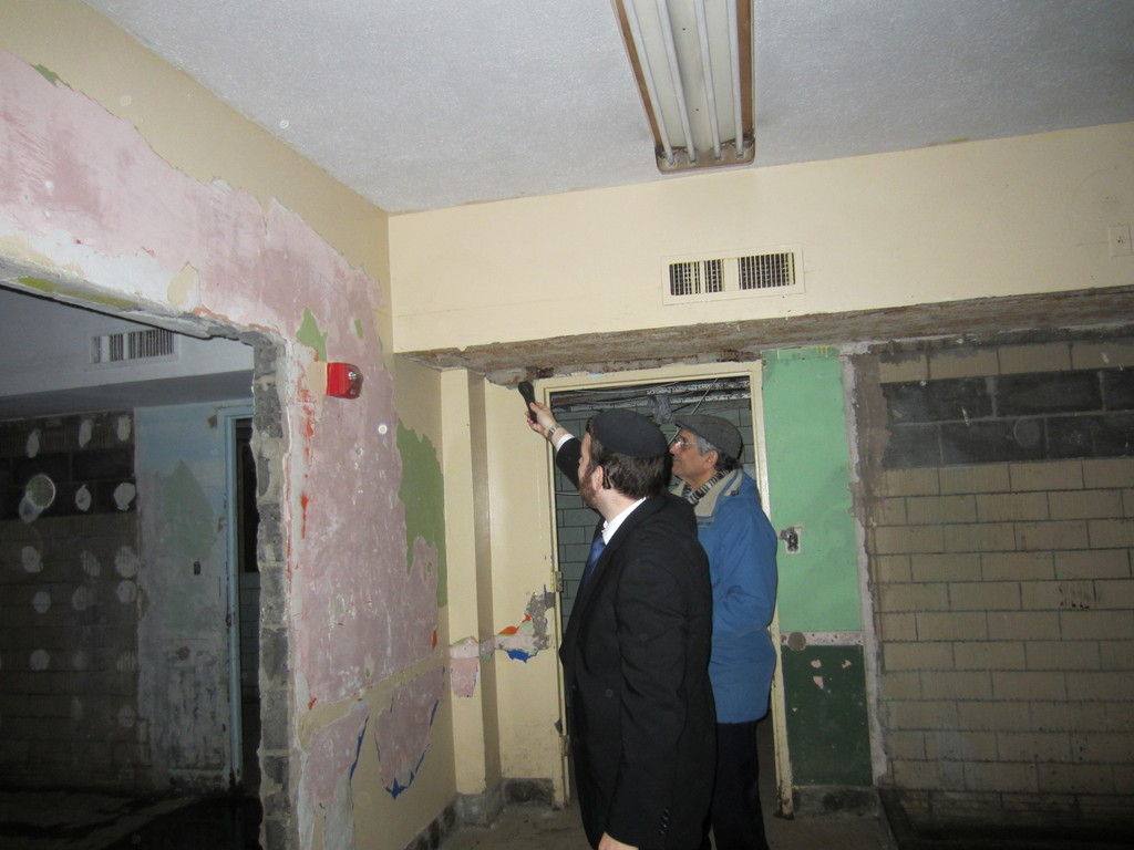 Rabbi Tsvi Selengut in the stripped down basement of Ohab Zedek after the destruction of Sandy.