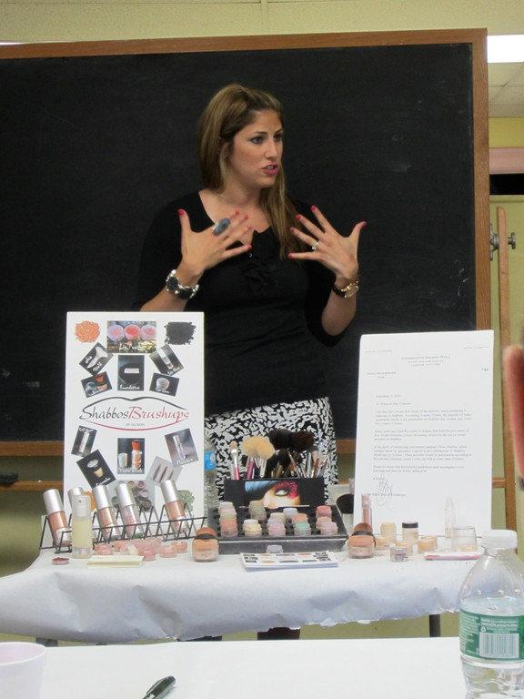 Alison Chait describes how to apply makeup on Shabbat, at a JCC event.