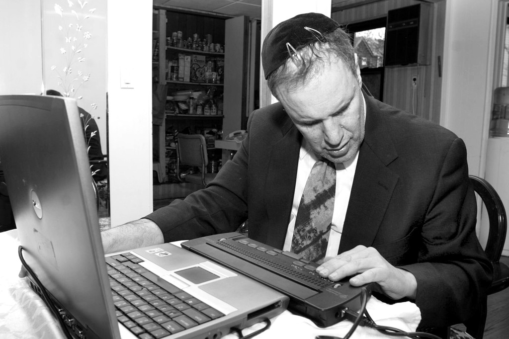 Rabbi Michael Levy at work on his blog.