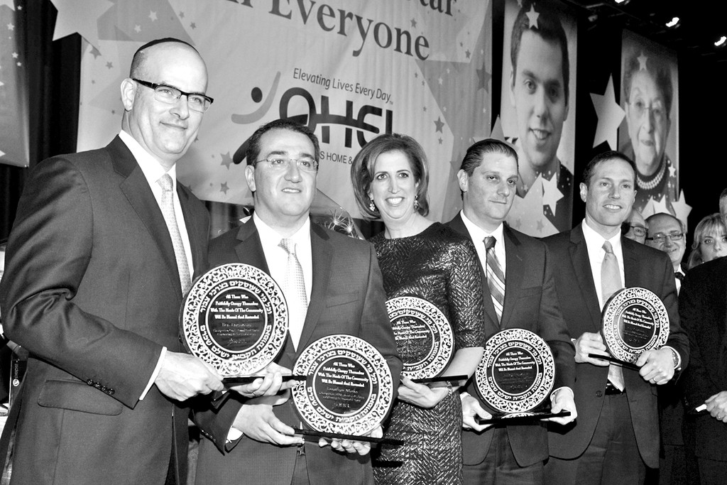 Pictured in photo from left, are Ben Englander, Jonathan Marks, Michelle Sulzberger, Jeffrey Schwartz, Izzy Kaufman, Chairpersons of the OHEL Omni Golf Classic, who were honored for ten successful years, at Ohel