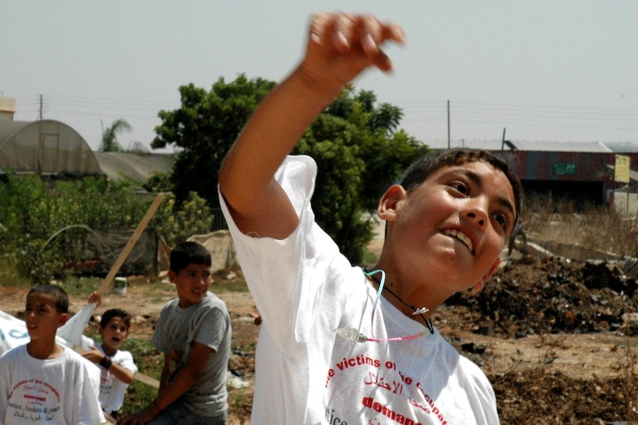 A Palestinian boy throws a stone at Israel