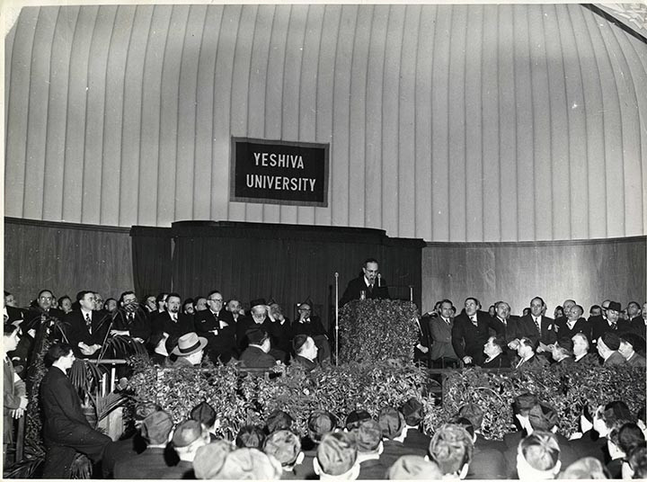 Rabbi Joseph B. Soloveitchik speaking at an early Chag Hasemicha at Yeshiva University.