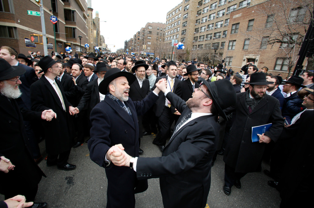 RIETS Rosh Yeshiva Rabbi Yona Reiss (left) is pictured dancing with RIETS Dean Rabbi Menachem Penner. YU Mashpia Rabbi Moshe Weinberger, rav of Congregation Aish Kodesh of Woodmere, is at center in an outer circle.