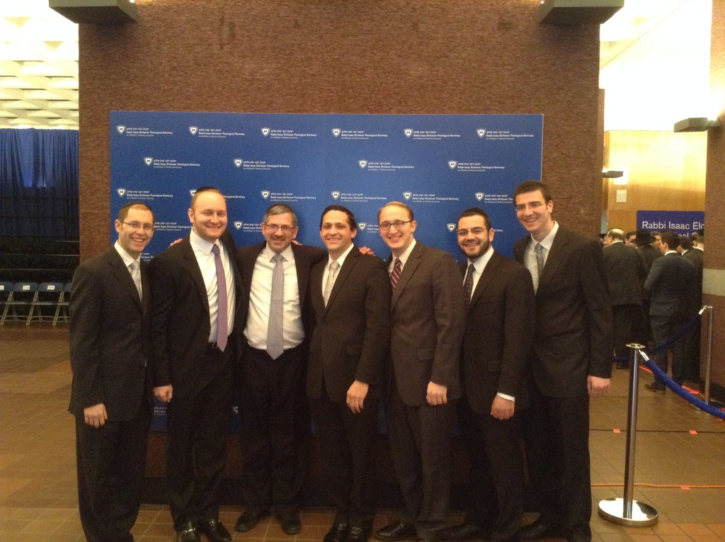Rabbi Zev Meir Friedman, Rosh HaMesivta of Rambam Mesivta in Lawrence, posed with five of the nine Rambam alumni musmachim. From left, Rabbis Daniel Bauer, Zev Aeder, Zev Friedman, Moshe Winograd, Avram Block, Yitzy Klein, Moshe Laster. (Not pictured: Ari Schwab, Ari Sendic and Jonathan Ziring.)